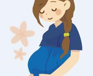 お腹をさする幸せそうな妊婦