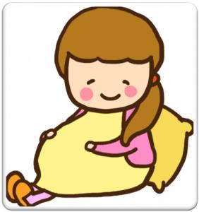 お腹を優しく抱える妊婦さん