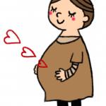 大きなお腹を抱えて幸せそうな妊婦さん